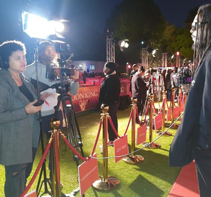 Don Dada at the Lion King premiere being interviewed
